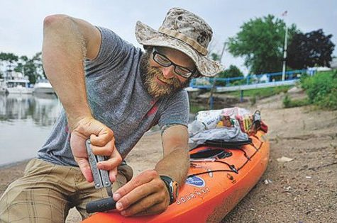 Image of a person doing Kayak MAintenance